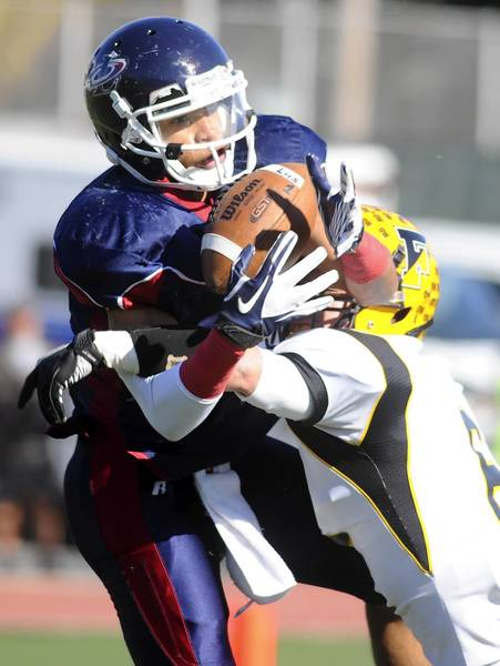 Liberty #2, Kier Williams, catches a pass and is defended by Freedom #6, Frank Bucsi, on Nov. 5, 2011.