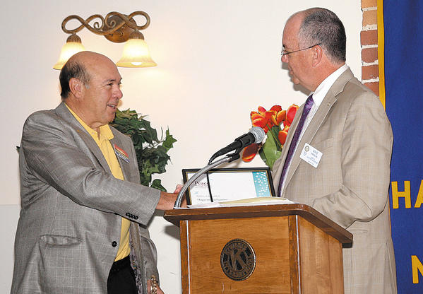 David Hanlin, right, assistant district governor representing District Gov. Jim Eberly, presented Rotary Club of Hagerstown-Sunrise President Al Smith, left, with the Presidential Citation for 2012-13.