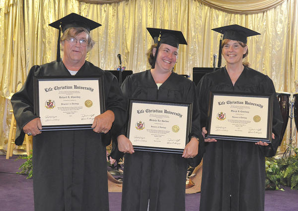 Pictured with their diplomas are Richard L. Churchey, left, who received a certificate of completion for program one; Michelle Lee Gordon, center, who graduated magna cum laude with a bachelor's degree in theology; and Sheryl J. Courtney, who graduated summa cum laude with a diploma in theology.