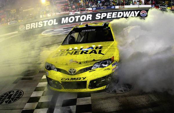 Matt Kenseth, driver of the No. 20 Dollar General Toyota, does a burnout after winning the NASCAR Sprint Cup Series 53rd Annual IRWIN Tools Night Race at Bristol Motor Speedway on Saturday night.