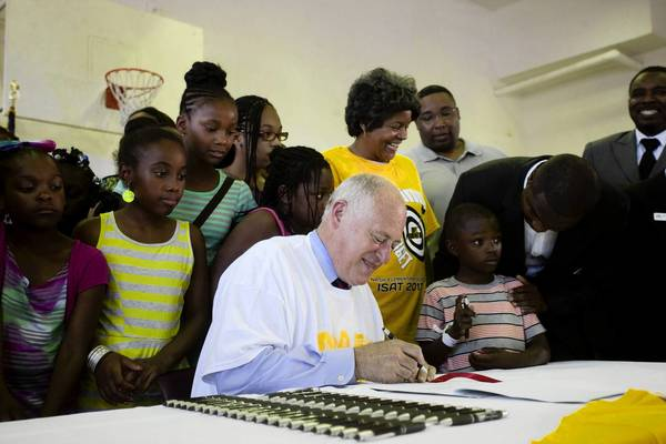 Gov. Pat Quinn on Sunday signs a bill lowering the Illinois compulsory school attendance age from 7 to 6 at Nash Elementary School in Chicago.