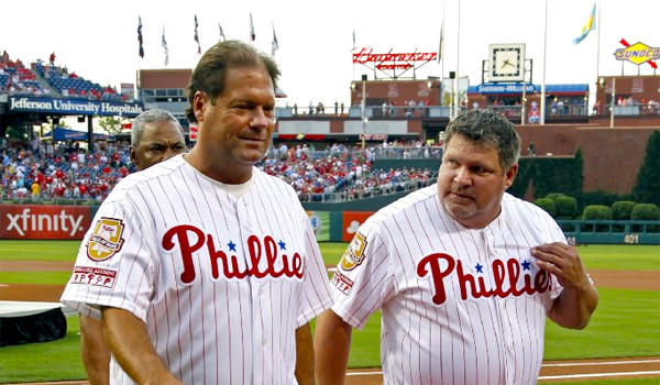 ESPN's John Kruk, right, was taken from the Dodgers press box on a gurney Sunday night before the Dodgers' matchup with the Boston Red Sox because of dehydration, ESPN announced in a statement.