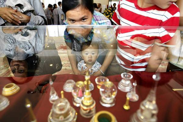 Visitors gaze at the Buddha relics at Lu Mountain Temple in Rosemead.