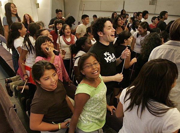 Conductor Gustavo Dudamel with music students in 2009.