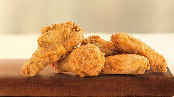 After a test in Atlanta and Chicago, McDonald's is adding Mighty Wings to its national menu.