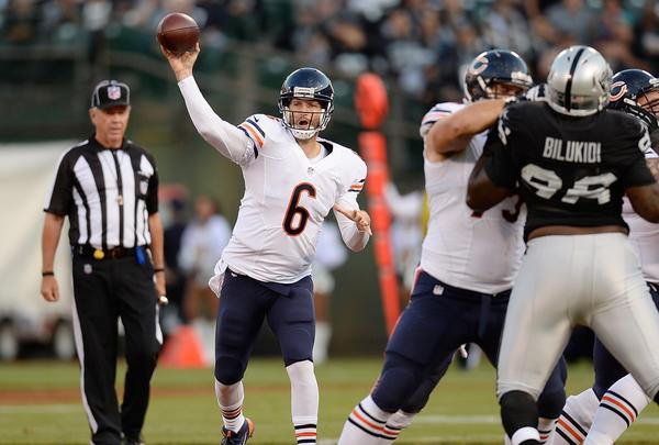 Bears quarterback Jay Cutler throws a pass during the first quarter against the Oakland Raiders Friday.