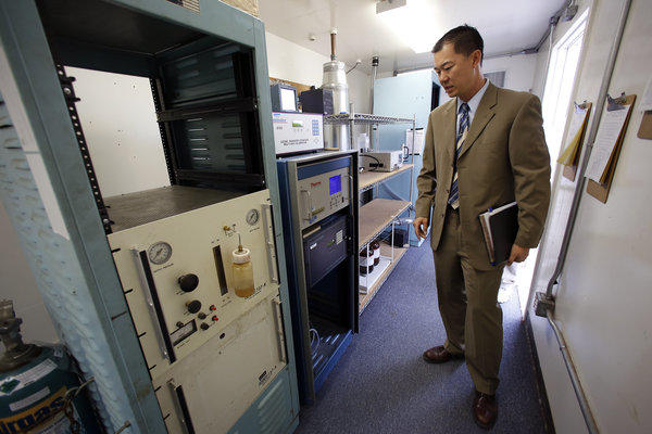 Jason Low, atmospheric measurements manager for the South Coast Air Quality Management District, at a special air monitoring station along the 710 Freeway in Long Beach.