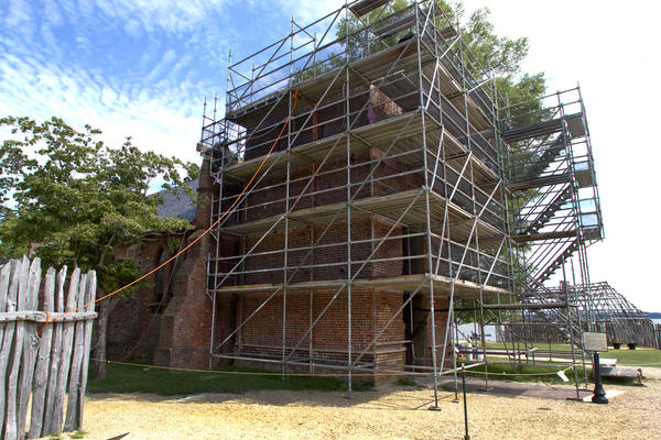 Built in the late 1600s, the Jamestown church tower is currently surrounded by scaffolding as restoration masons replace crumbling bricks and repoint the oyster-shell mortar.