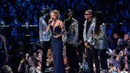 Taylor Swift drops F-bomb at MTV VMAs as Harry Styles presents