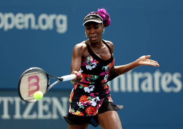 Venus Williams cruised Monday into the second round of the U.S. Open.