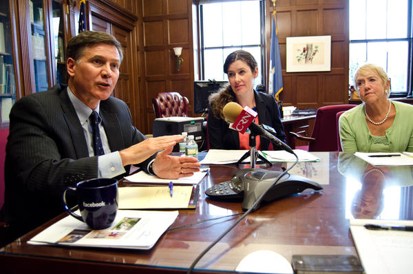 Energy commissioner Dan Esty spoke to reporters Monday about the expanded energy efficiency budget, with Deputy Commissioner Katie Dykes and Jessie Stratton, the department's director of policy development.