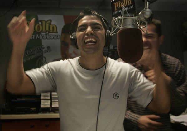 "Eddie ""Piolin"" Sotelo sued six former employees on his radio program, alleging they were participating in a plot to extort nearly $5 million from the Spanish-language radio star. Above, Sotelo at his former Univision studio working at Spanish-language radio station KSCA-FM (101.9) in Glendale."