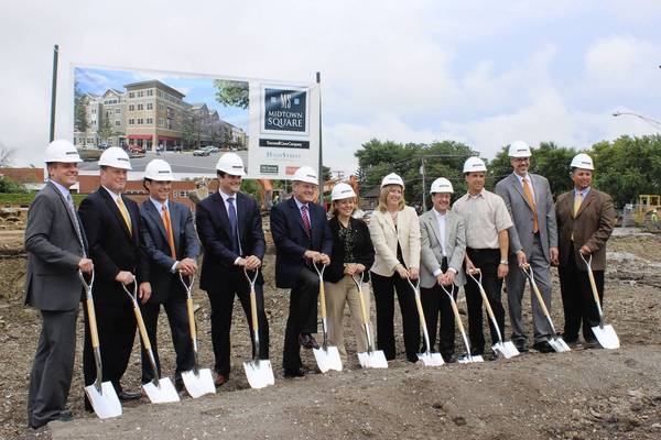 Village of Glenview officials and Trammell Crow Company representatives celebrate breaking ground for the new four-story development on Aug. 22 near the downtown Glenview.