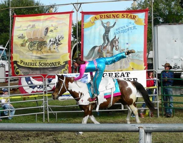 Benna Sandlofer performs trick riding during the new Animals that Built America show at the Allentown Fair, Aug. 27-Sept. 2.
