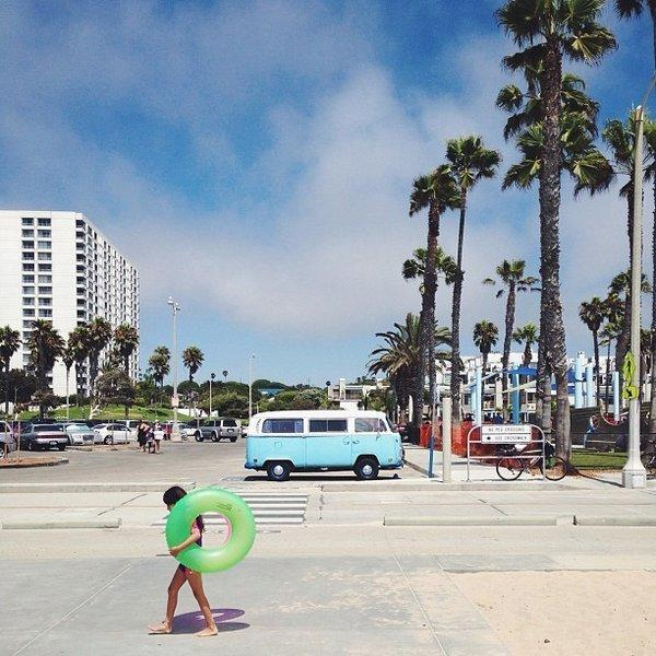 A girl walks past a VW van on Venice Beach.