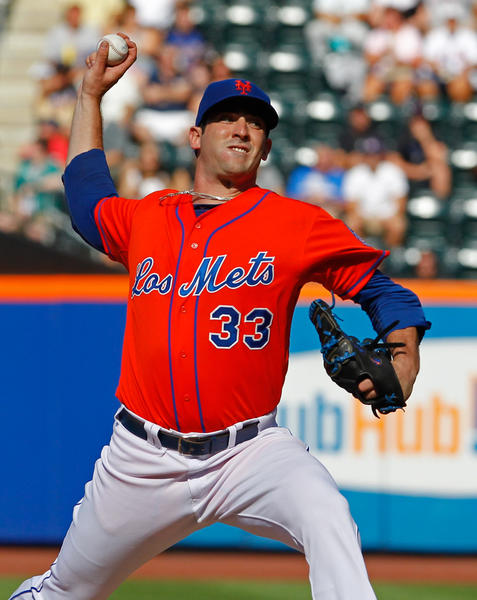 New York Mets starting pitcher Matt Harvey (33) delivers a pitch against the Detroit Tigers at Citi Field. The pitcher tore a ligament in his elbow and will be out for the rest of the season.