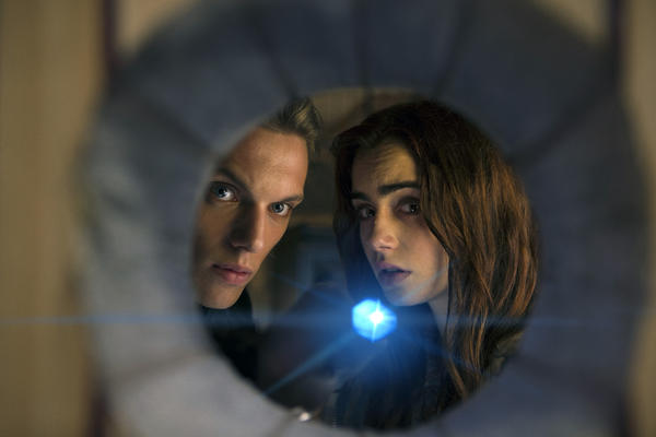 "This film publicity image released by Screen Gems shows Jamie Campbell Bower as Jace, left, and Lilly Collins as Clary in a scene from ""The Mortal Instruments: City of Bones. (AP Photo/Sony Pictures Screen Gems, Rafy)"