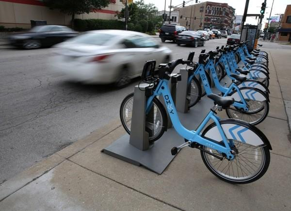 Divvy bike share station on Chicago Avenue at Ogden Avenye