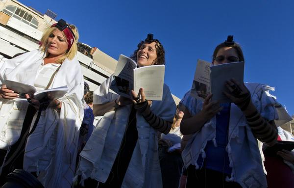 Members of the Women of the Wall group wear prayer shawls and tefillin boxes at a service in the plaza facing the Western Wall on Aug. 7, 2013.