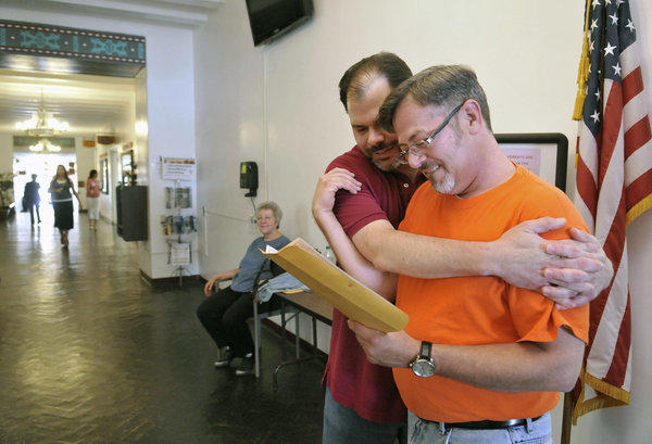 Todd Crawford, left, and Jimmy Huckaby embrace after receiving their marriage license at the Santa Fe County clerk's office in New Mexico.