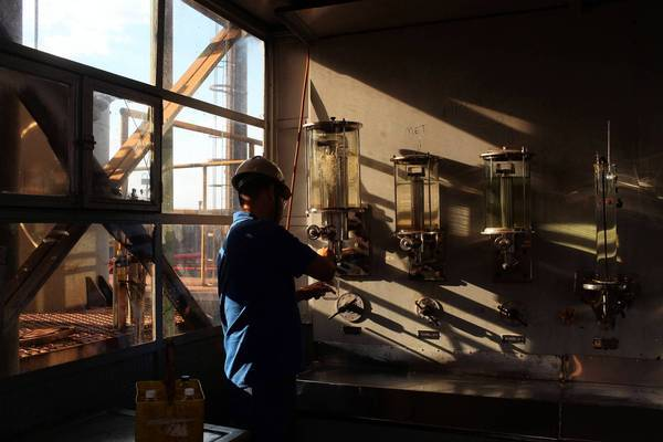 A worker tests the quality of ethanol samples at Louis Dreyfus Commodities' Biosev processing facility near Sertaozinho, Brazil. The country makes large amounts of ethanol from sugar cane.