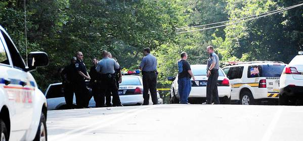 State and local police seal off Route 54 in Mahanoy Township after a police officer shot a man Monday afternoon following a police chase.