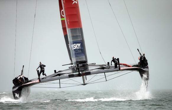 This is Emirates Team New Zealand, skippered by Dean Barker in action during race eight on Sunday of the Louis Vuitton Cup finals against Team Luna Rossa.