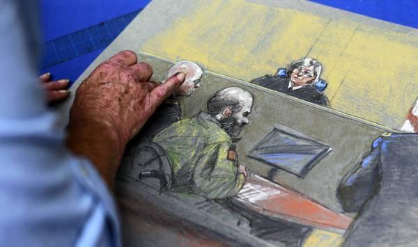 Artist Brigitte Woosley works on a sketch showing Maj. Nidal Malik Hasan as testimony begins in his sentencing at Ft. Hood.