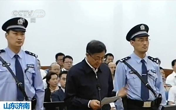 Purged politician Bo Xilai reads a statement in his closing arguments during his trial in Jinan, China.