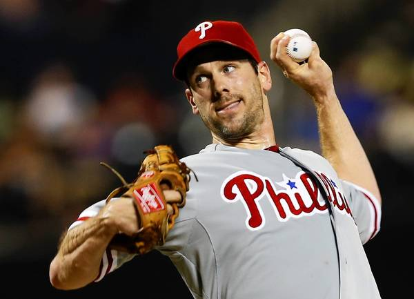 Phillies pitcher Cliff Lee held the Mets to five hits and one run over eight innings.