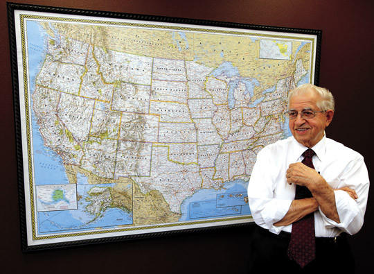 The Rev. Harold Salem talks about the Christian Worship Hour broadcast which has grown to cover much of the United States and is seen and heard world wide. The pins on the map behind Salem designate the cities with stations that carry the broadcast. photo by john davis taken 8/20/2013