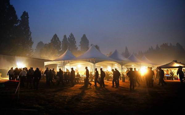 Fire crews line up for breakfast as dawn breaks over the smoke-filled Rim fire base camp.