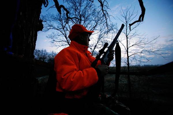 A Wisconsin hunter sits in a tree stand during white-tailed deer season. It is illegal for hunters to bring into Pennsylvania certain deer carcass parts from Wisconsin and 20 other states.
