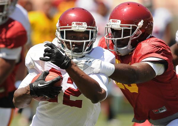 Justin Davis runs with the ball during practice earlier this month.