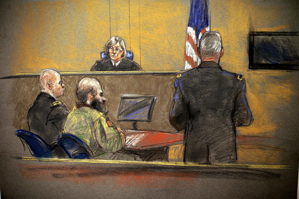 In a courtroom sketch, convicted Ft. Hood gunman Maj. Nidal Hasan, center, sits before the judge, Army Col. Tara Osborn, during the sentencing phase of his trial.