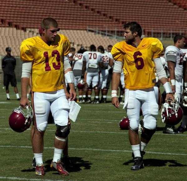 Max Wittek, left, and Cody Kessler walk off the field after practice.