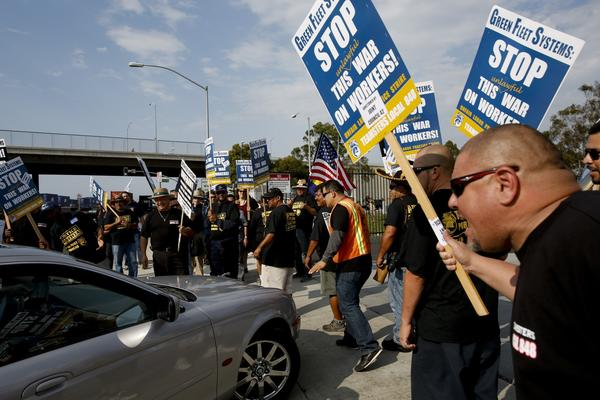 A port truck driver strike Monday evening kicked off a week of planned labor actions and demonstrations. Above, drivers picket outside Green Fleet Systems in Carson.
