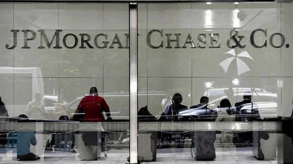Customers are shown in the lobby of JPMorgan Chase headquarters in New York in a 2012 file photo.