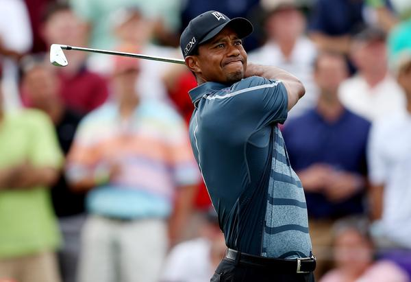 Tiger Woods will miss the NB3 Challenge charity event this week because of back spasms.
