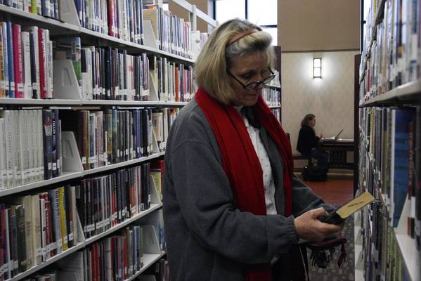 Glenview resident Barbara Carolan browses the shelves at the Glenview Public Library in February.