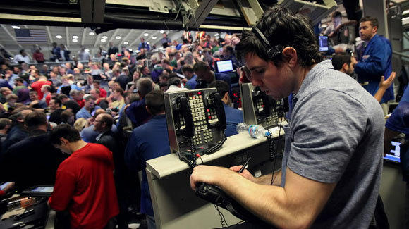 Traders work on the floor of the Chicago Board Options Exchange in April.