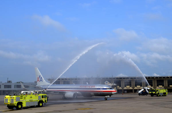 Bradley International Airport firefighters spray American Airlines flight 1353 with water canons to mark the inaugural non-stop flight to Los Angeles.