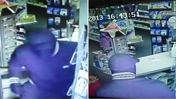 Surveillance photos released by Connecticut State Police of an armed masked man who robbed a pharmacy in Somers Friday.