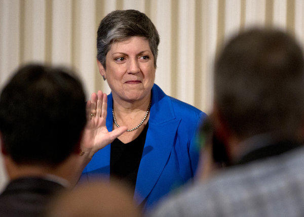 Homeland Security Secretary Janet Napolitano waves as she leaves after delivering her farewell address at the National Press Club in Washington, D.C.