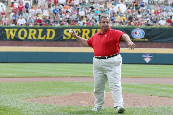 New Jersey Gov. Chris Christie throws out the ceremonial first pitch before the start of the Little League World Series championship game in Williamsport, Pa.