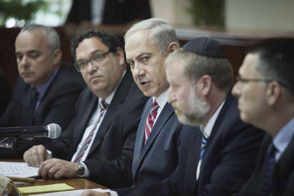 Israeli Prime Minister Benjamin Netanyahu, center, speaks during the weekly Cabinet meeting in Jerusalem.