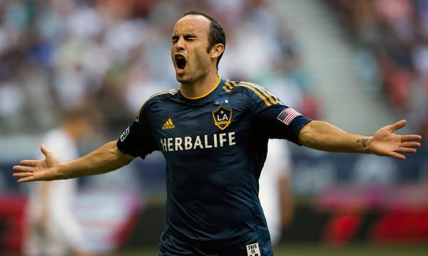 Landon Donovan, the most decorated player in MLS history, has reached an agreement to remain with the Galaxy. Above, Donovan celebrates after scoring a goal Saturday against the Vancouver Whitecaps.