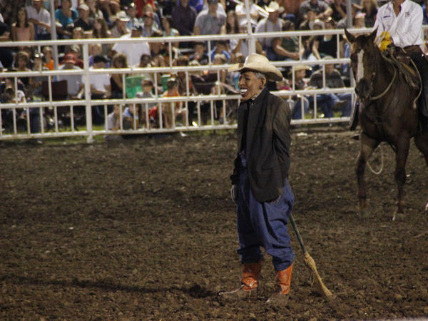 "A clown wears a mask bearing the image of President Obama at the Missouri State Fair. The announcer asked the crowd whether anyone wanted to see ""Obama run down by a bull,"" according to a spectator. ""So then everybody screamed.... They just went wild,"" said Perry Beam, who attended the rodeo at the State Fair in Sedalia. State Fair officials apologized, calling the skit inappropriate and disrespectful."