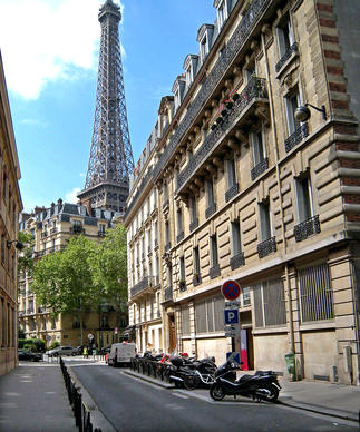 The American Library in Paris, a literary hangout in the expat days of Fitzgerald and Hemingway, continues to thrive. Its home in the building on the right huddles close to the Eiffel Tower.
