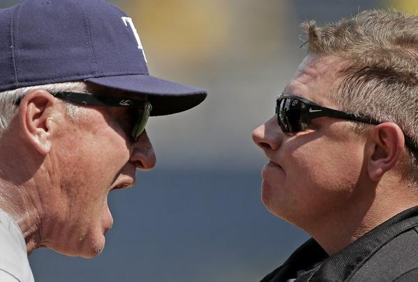 "Getting into the ""defensive peripersonal space"" of plate umpire Greg Gibson, right, got Tampa Bay Rays Manager Joe Maddon thrown out of a game Monday."